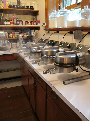... waffle makers bake simultaneously. When you're feeding waffles to a